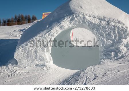 frozen tunnel, snowpark in dolomites mountains, the alps - stock photo