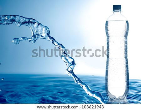 Frozen water and bottle of water - stock photo