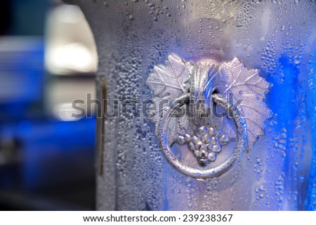 Frozen water drops on ice bucket - stock photo