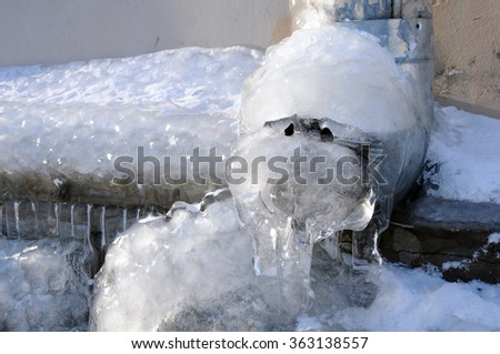 Frozen water in the downspout in the winter in Russia - stock photo