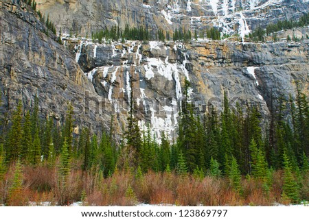 Frozen waterfalls on mountain cliff, Icefields Parkway, Banff and Jasper National Parks Alberta Canada - stock photo