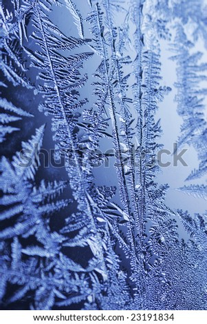frozen window blue glass background frost ice - stock photo