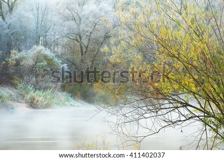 Frozen winter landscape. Trees with the hoar-frost and a river - stock photo