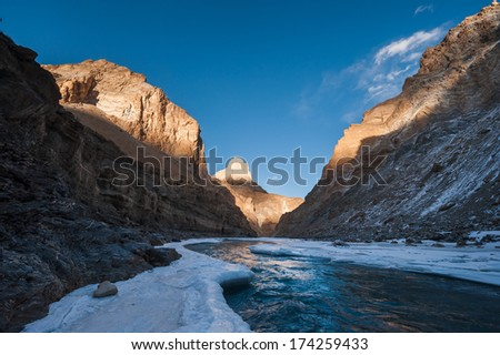Frozen Zanskar river, with Indian Himalayas in late afternoon light - stock photo