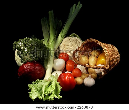 Fruit and vegetables at a market stand - stock photo