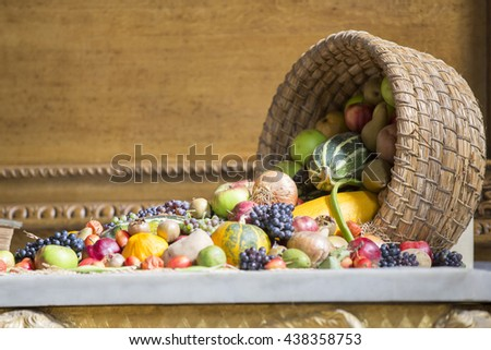 Fruit and vegetables fallen out of  wicker basket. - stock photo