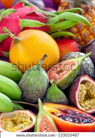 Fruit background .Mix of many fresh tropical fruits . - stock photo