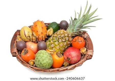 Fruit basket, exotic fruits - stock photo