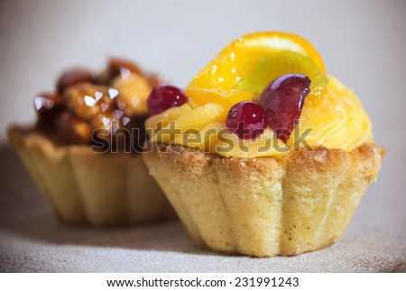 Fruit cake and nuts cake in the background with heart shaped bokeh  - stock photo
