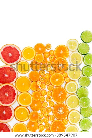 Fruit citrus background with grapefruit, orange, tangerine, lemon, lime and kumquat on white background. Top view. Flat lay. - stock photo