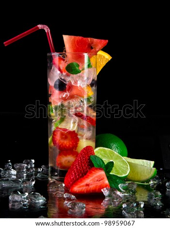 Fruit cocktail over black background - stock photo