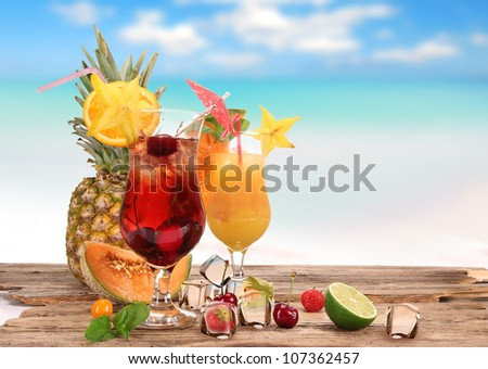 Fruit cocktails on a beach - stock photo