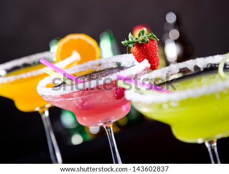 Fruit cocktails on black background - stock photo