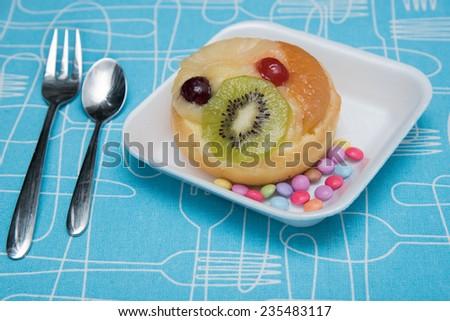 fruit doughnut with cherry and kiwi - stock photo