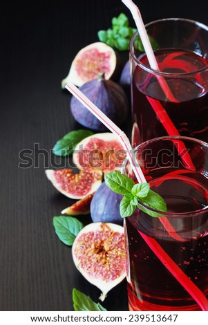 fruit drink and ripe figs on a black background.health and diet food. selective focus - stock photo