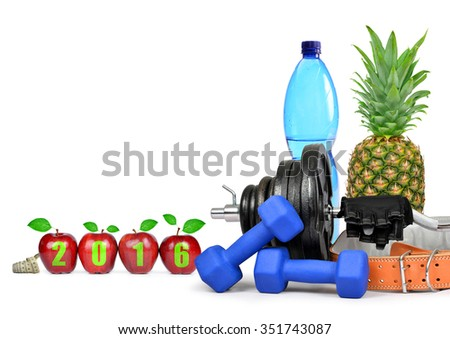 Fruit, dumbbells and PET bottle with drinking water. Healthy resolutions for the New Year 2016 - stock photo