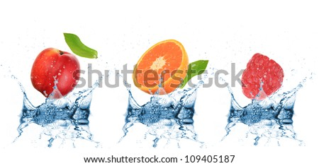 Fruit falling into water over white - stock photo