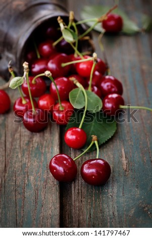 Fruit food concept. Fresh cherries on wood - stock photo