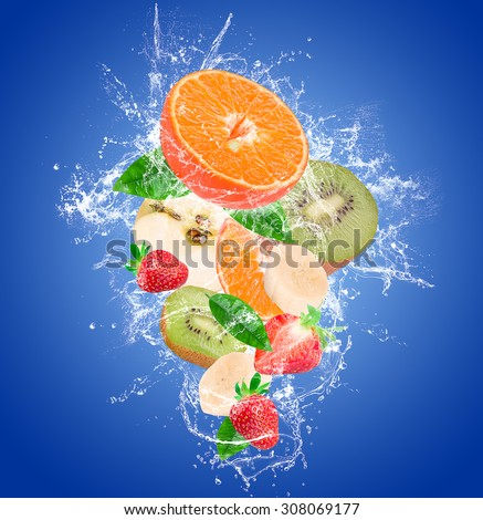 fruit in a spray of water on a blue background - stock photo