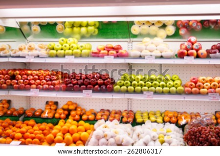 fruit in a supermarket shelve in blurry for background - stock photo