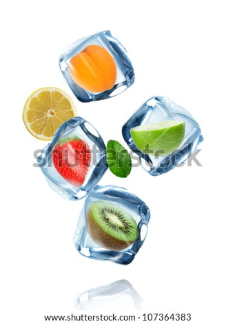 Fruit in ice cubes in motion - stock photo