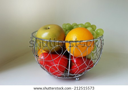 Fruit in the stainless basket - stock photo