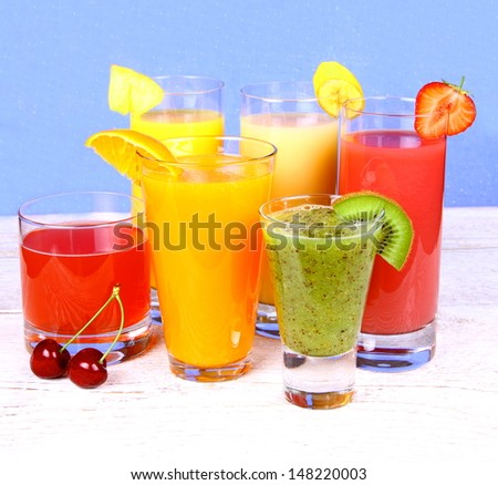Fruit juices from kiwi, cherry, orange, strawberry, banana, pineapple, vertical - stock photo