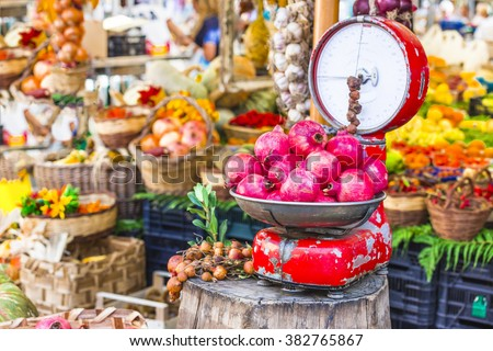 Fruit market with old scales and garnet in Campo di Fiori, Rome - stock photo