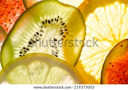 fruit mix (fig, lime, lemon, orange, kiwi) - stock photo