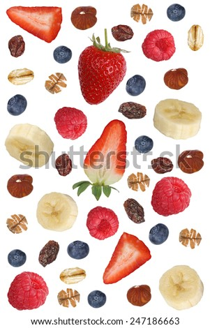 Fruit muesli ingredients for breakfast with fruits like raspberry, blueberries, banana and strawberry - stock photo