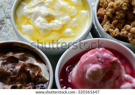 Fruit muesli with yogurt and cereals for breakfast - stock photo