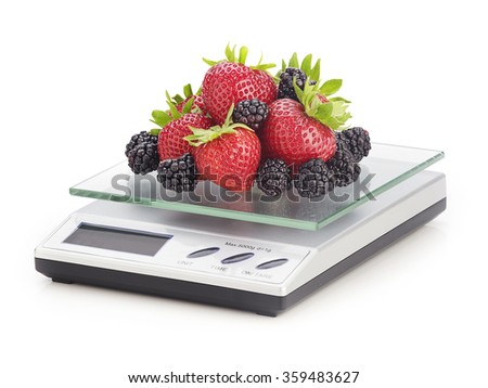 fruit on a kitchen scale - stock photo