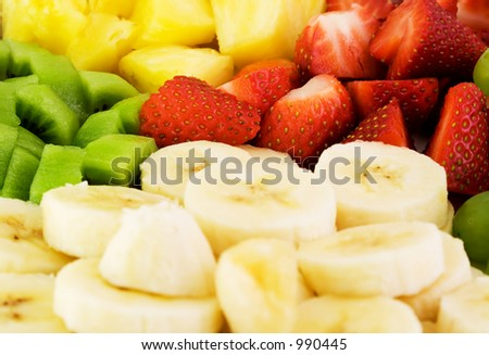 Fruit plate with bananas, strawberries, kiwis and pineapple - stock photo