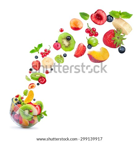 fruit salad ingredients in the air in a glass bowl isolated on white background - stock photo