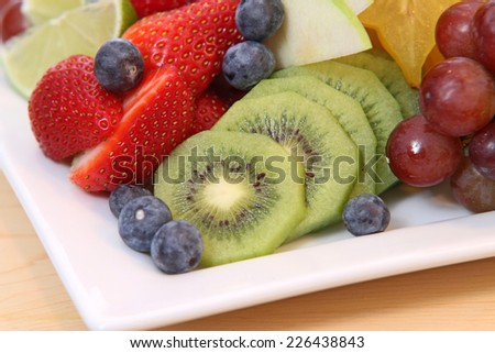 Fruit salad on plate and ready to eat - stock photo