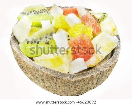 fruit salad with kiwi mango and honeymelon in coconut - stock photo