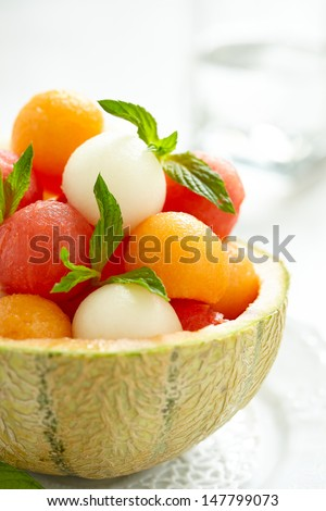 Fruit salad with melon and watermelon balls in cantaloupe bowl - stock photo