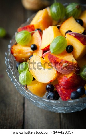 fruit salad with peaches with berries, close up food - stock photo