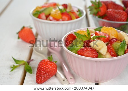 Fruit salad with strawberries on a white background - stock photo