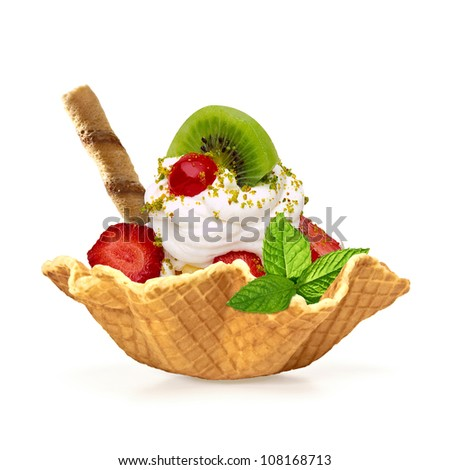 Fruit salad with whipped cream in wafer bowl - stock photo