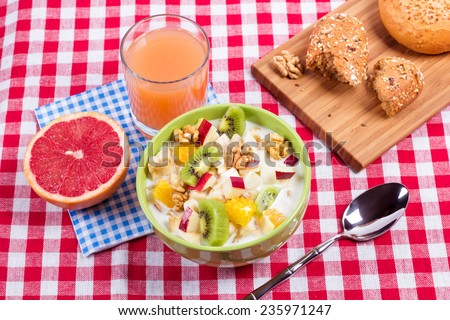 Fruit salad with yogurt and fresh juice with half a grapefruit for breakfast. Vegetarian lunch. Healthy eating for weight loss. Fruit diet. - stock photo