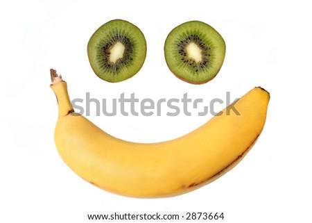 Fruit smile with kiwi eyes and banana mouth isolated on white. - stock photo