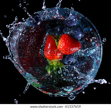 fruit splashing into a glass. Concept - make a splash - stock photo