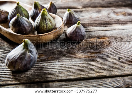 fruit still-life - tray of organic green and violet figs set on wooden tray on wood background for genuine texture effect and food freshness - stock photo