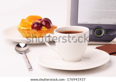 Fruit tartlet and coffee with a tablet pc - stock photo