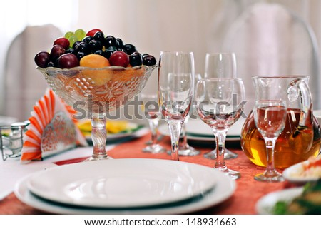 Fruit wine glasses in a restaurant table setting - stock photo