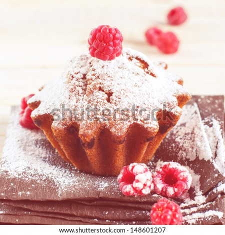 Fruitcake Decorated by Raspberry and icing sugar, toned, square - stock photo