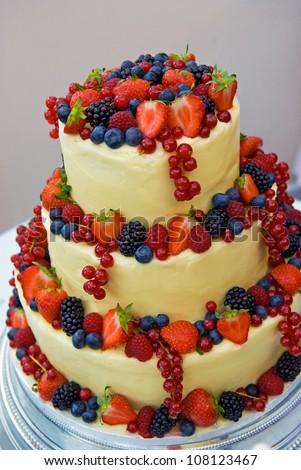 Fruitful wedding cake at reception - stock photo