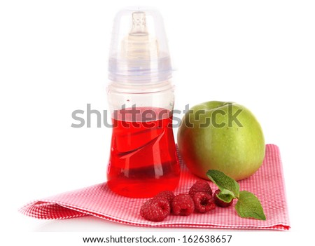 Fruits and baby bottle with compote on napkin isolated on white - stock photo