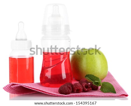 Fruits and baby bottles with compote on napkin isolated on white - stock photo